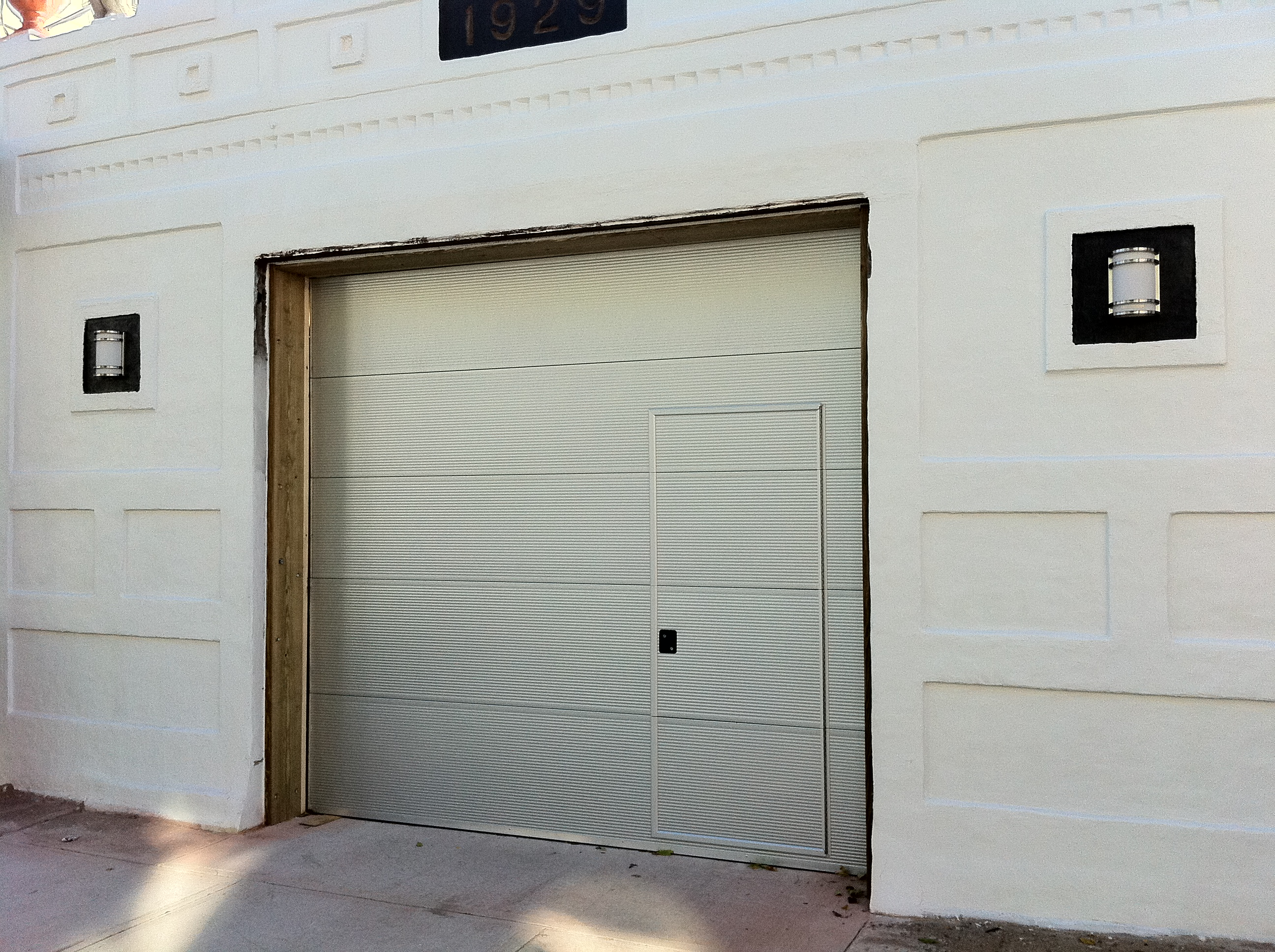 Which type of garage door to get for security but access for Drive through garage door